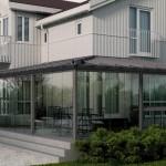 Innglasset terrasse - Vinterhager i grå, store vinduer